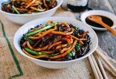 "6 oz. lean pork ¼"" strips 3/4 t cornstarch ½ t light soy sauce 1/8 t dark soy sauce 1 t shaoxing wine Pinch of sugar 3 T oil divided  8 shiitake mushrooms thinly sliced 1 lb. Japanese-style Udon noodles 2 1/2 t dark soy sauce 2 1/2 t soy sauce ¼ t sugar  1 small bunch choy sum or baby bok choy"