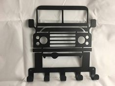 LAND ROVER Key / Coat / Towel Rack CNC Plasma cut & powder coated with choice of colours and styles Mounts easily with two holes and have 5 hooks so you never loose your keys again. Dimensions: 207mm wide by 224mm tall Professionally finished in high quality Powder Coating. Please select