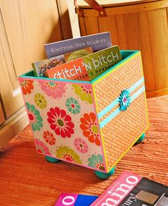 Update a storage bin with bright paint, papers and Mod Podge.