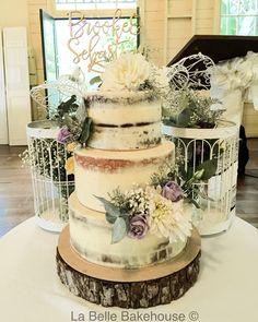 Semi naked buttercream wedding cake with fresh flowers