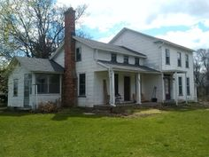 *house from front right with porch*