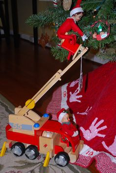 Elf on the Shelf idea .Lil' help decorating the tree