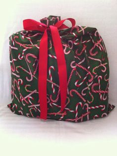 wrap in a snap. Reusable Fabric Gift bags made in Pennsylvania USA of eco friendly material. Ribbon attached. open, drop, tie, go! kitchentable4.com @VZWraps Fabric Gift Bags