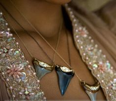 gold dipped shark tooth necklaces.