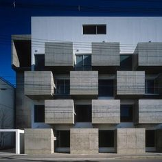 Chunky concrete boxes form a grid of secluded balconies across the facade of this apartment block in Kyoto.    Click here for more: http://www.dezeen.com/?p=253949
