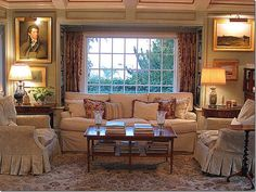 love the slipcovered chairs and couch!! elegant and casual