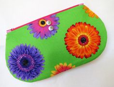 Floral Zipper Pouch, pouch, coin pouch, pen case, makeup pouch Can you say flower power! This pouch is so bright and cheerful I can't resist. Get your here:https://www.etsy.com/listing/236978266/floral-zipper-pouch-pouch-coin-pouch-pen?ref=shop_home_active_6&ga_search_query=floral