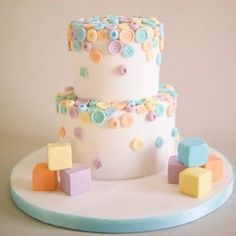 this baby shower cake is so adorable. the cute buttons make great cake decor