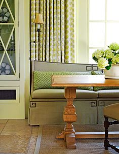 "I love the style and shape of this banquette, in between cabinetry also designed by Phillip Sides.     Traditional Home September 2012.  Photo by Tria Giovan.  Interior design by Phillip Sides.     Banquette (custom); upholstering (by E.J. Wright): Phillip Sides Interior Design, 334/240-3333, phillipsidesinteriordesign.com.   Banquette fabric (""Olga""/Pistachio #9759): Pindler & Pindler, 805/531-9090, pindler.com."