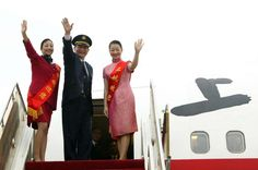January 29,   2005: First direct Shanghai‐Taiwan flight since 1949  -   Captain Ding Xingguo ﴾c﴿ and two attendants wave as they board a direct flight from Shanghai to Taiwan at the Pudong International Airport, in Shanghai Eastern China. Chartered direct flights were launched to carry passengers to their hometowns for the spring festival.