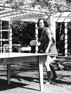 Joan Crawford. Playing ping pong. Through the lens of Durward Graybill.