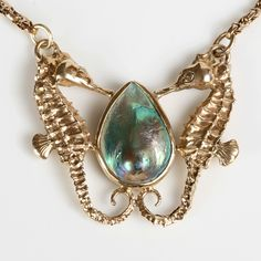 9ct Gold Seahorse Necklace with a Paua Pearl. Made by Sparrow & Co Jewellery.