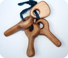organic baby teether using maple or cheery wood with organic flax oil.  safe and non toxic.