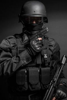 Buy SWAT police officer with pistol by Getmilitaryphotos on PhotoDune. Spec ops police officer SWAT in black uniform with pistol studio Swat Police, Police Officer, Military Special Forces, Army Wallpaper, Military Guns, Military Pictures, Navy Seals, Survival Gear, Law Enforcement