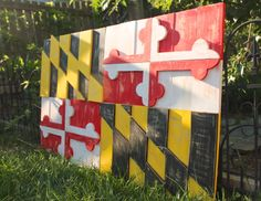 Oversized wooden distressed Maryland Flag.