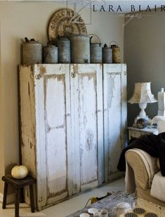 Love the cabinet and the metal containers on top!  would love this for the mud porch!