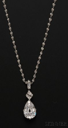 Important Art Deco Platinum and Diamond Pendant Necklace, Cartier, New York, set with a pear-shape diamond weighing 7.93 cts., and a kite-shape diamond weighing approx. 0.70 cts., and a baguette, lg. 1 3/8 in. suspended from a diamond chain set with 133 diamonds, lg. adjustable from 24 3/4 to 17 1/8 in., pendant signed and numbered 350, boxed.
