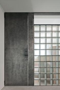Neri&Hu transforms Beijing missile factory into car workshop Door Design, Wall Design, House Design, Glass Brick, Glass Door, Glass Art, Glass Blocks Wall, Neri And Hu, Garage Pictures