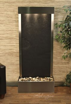 This contemporary Harmony River wall hanging water feature is perfect for the living room.  All of my friends compliment my freestanding water feature; I have no regrets, everything about my experience was enjoyable. Visit http://www.waterfeaturesupply.com/waterfalls/serene-waters-lw-slate-wall-water-feature.html for more information on the Harmony River freestanding water feature.