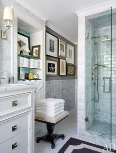 Small perfect white marble bath - tiles, grey paint, pictures.