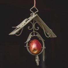 """Ornate Fruit Bird Feeder; $20.00 Add some fun to your yard with our metal ornate scroll apple bird feeder! The details are gorgeous and intricate with leaves and scrolls. Made of metal.(10.5"""" x 2.5"""" x 12.5""""H ) Antique Farm House"""