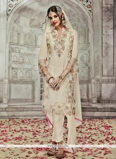 Be your diverse vogue diva with this cream georgette designer suit. The ethnic embroidered and resham work with a clothing adds a sign of attractiveness statement to your look. Comes with matching bot...