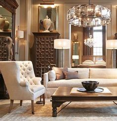 Need help choosing a sofa? See these tops on www.in-form-design.com. Pale cream white tuxedo sofa with tufted wingback in chick traditional setting with chandelier
