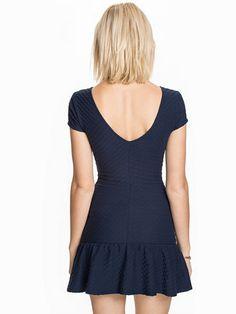Low Peplum Dress