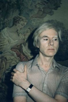 Flying High: Cartier in Motion Andy Warhol wears a 'Tank' wristwatch by Cartier, 1970 © THE ANDY WARHOL FOUNDATION FOR THE VISUAL ARTS INC