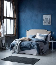 Loving the petrol blue walls with grey bed and dark linen bedding. Want to do this in our bedroom!
