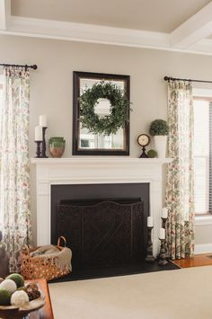 Simple fireplace decor ideas for spring and summer from www.simply2moms.com | #decor #boxwood #green #mirror #mantel #farmhouse