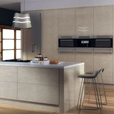 High gloss kitchen Doors are visually stunning, hard-wearing and epitomise a modern home. With lighter colours in particular, gloss reflects natural light and creates a sense of space. Combine this with a simple slab or handleless door and the effect is accentuated. If you have a small kitchen or a kitchen with little natural light, this on-trend look could be the very thing. For an award-winning design and great value, take a look at Zurfiz - shown here in Ultragloss Limestone. Sleek… High Gloss Kitchen Cabinets, Kitchen Cabinet Doors, Light Colors, Colours, Handleless Kitchen, Natural Light, Lighter, Space, Stylish