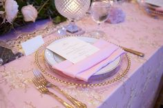 Pink Linens with Gold Flatware %26 Chargers    Photography: Painted Peacock Photography   Read More:  http://www.insideweddings.com/weddings/romantic-wedding-with-crystal-elements-at-a-chateau-in-houston-tx/1014/