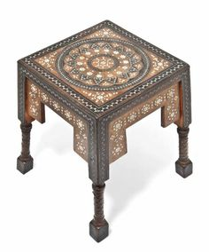 CARLO BUGATTI (1856-1940) WALNUT, COPPER AND INLAID STOOL, circa 1900, The seat and shaped sides inlaid with pewter and bone, the legs wrapped with embossed copper, 16¼ in. (41.2 cm.) high, top 12¼ in. (31 cm.) square     SOLD $6,105 Christie's London, Feb. 4, 2014