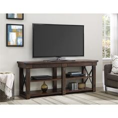 The Altra Wildwood Veneer 65-inch TV Stand brings both beauty and organization to your living room. This wood veneer TV stand holds a flat screen TV up to 65 inches wide. Store your DVD player, cable