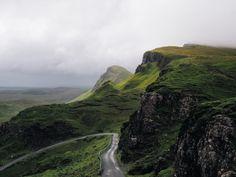 green grass highland grassland landscape nature mountain road trip travel outdoor sky clouds