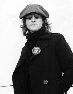 "John Lennon. His pin says, ""Listen to The Beatles"" LOL."