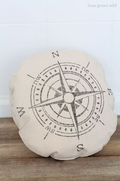 I created this cute little compass pillow using the same technique as the stenciled chandelier pillow. The round pillow cover lends itself perfectly to the compass design.