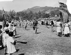 Fred Solomon leads the foot race at one of the Los Angeles orphans' outings he sponsored annually in Topanga, circa 1920s. This property became a shopping center in the late forties. San Fernando Valley History Digital Library.