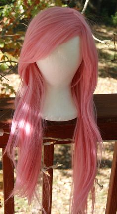 Fall in love with this Princess Pastel Pink wig!! * Low/med heat resistant * Hand feathered, long layers  * Thinned and shaped side swept fringe
