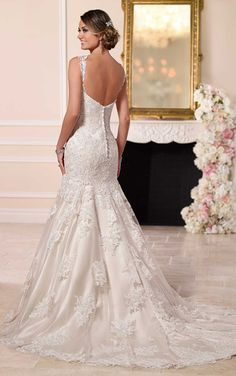 Looking for a sexy, yet sophisticated wedding dress for your big day? This lace over Dolce Satin fit-and-flare Stella York bridal gown offers just the right amount of chic elegance with its lace shoulder straps, plunging neckline, fitted drop bodice, and chapel train. Choose from a corset closure or a zipper closure under fabric-covered buttons.