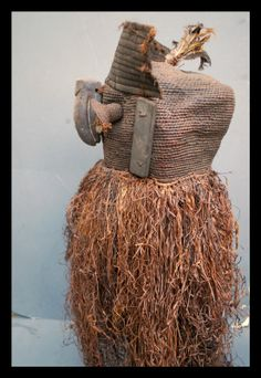 This is an impressive large raffia mask from the Congo .  The large sized mask is made from palm leaf raffia with the nose from light wood .  Nice used feel and patina to raffia .  In good condition.   Custom mounted on a metal base at cost of £45 included .  We guarantee that this item has been tribally used.  Height approx 100cm