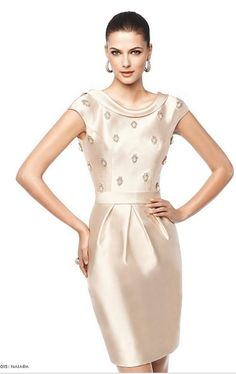 Creamy dress with embellishments