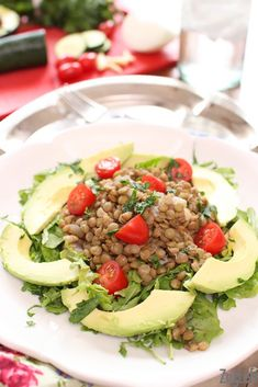 This fresh tasting, easy to make Lentil Avocado Salad with a light dijon vinaigrette is topped with tomatoes and avocados. It's a wonderful meatless main salad.   ZagLeft