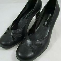 Etienne Aigner Black Cutout Pumps This is a great pair of pumps for any occasion.  Sweet cutouts remind me of butterflies.  Black leather uppers.  Very little wear, excellent pre-loved condition. Etienne Aigner Shoes Heels