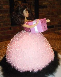 Barbie cake holding gift with Loralei's name on it. Cute idea!