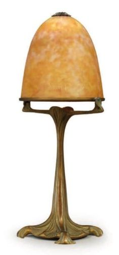 Maurice Dufrène (1876-1955) - Table Lamp with Daum, Nancy Glass Shade. Bronze with Glass Shade. France. Circa 1900. 39.5cm x 14.5cm.
