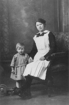 Servant with child, ca. 1920 -