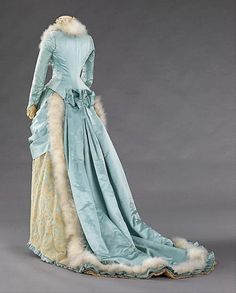 46.151.1_threequarter_back_bustle late 1870s - early 1880s. With all these frills, drapes and mermaid tail)