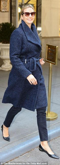 All smiles: Ivanka was the picture of elegance in a belted wool coat, skinny jeans, and bl...